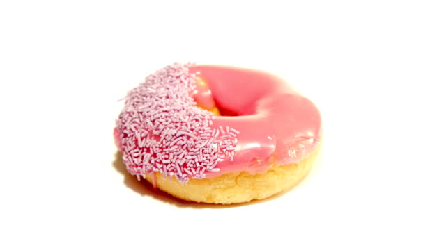 pink donut - doughnut stock videos and b-roll footage