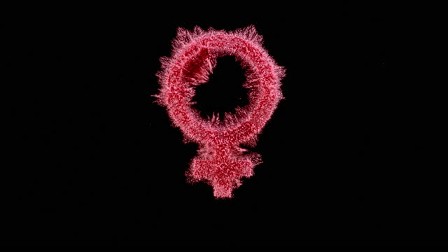 slo mo ld pink dust falling onto a black surface and creating a female gender symbol - gender symbol stock videos & royalty-free footage