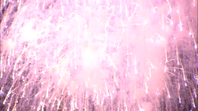 Pink fireworks explode in display, Japan