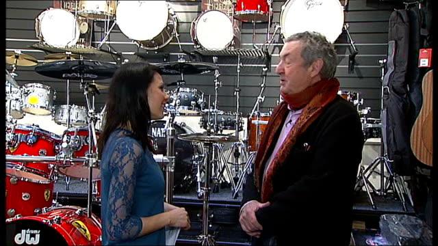 pink floyd drummer nick mason saves music shop from closure close shot mason talking mason behind drum kit and hitting cymbal nick mason interview... - cymbal stock videos and b-roll footage