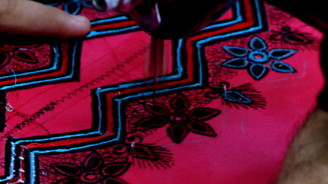 cu of pink garment being stitched on sewing machine at souk, muscat, oman - oman stock videos & royalty-free footage