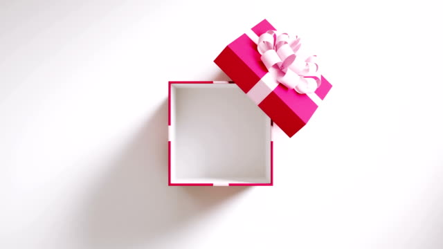 pink gift box opening on white background in 4 k resolution - open stock videos & royalty-free footage
