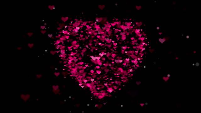 4 k ピンクのハート形の単発背景 - レプリカ点の映像素材/bロール