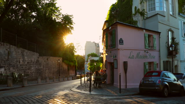 pink house in montmatre district at sunset - city break stock videos & royalty-free footage