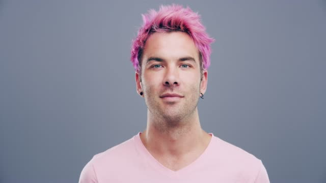 pink makes me happy - males stock videos & royalty-free footage