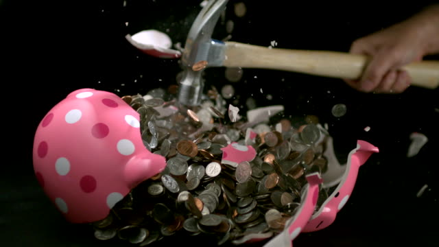 cu slo mo pink polka dot piggy bank being hit with hammer, black background / studio, new jersey, usa - polka dot stock videos and b-roll footage