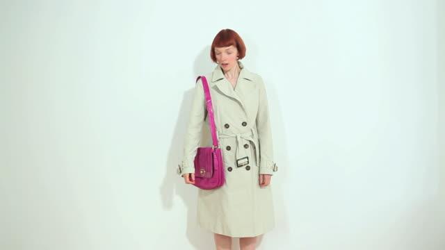 ms pink shoulder bag sliding onto woman / london, uk - shoulder bag stock videos & royalty-free footage
