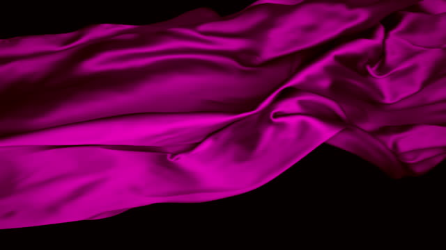 pink silky fabric flowing and waving horizontally in super slow motion and close up, black background - super slow motion stock videos & royalty-free footage