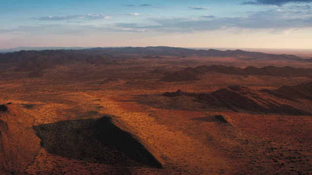 A pink sky hangs over the Kalahari Desert. Available in HD.