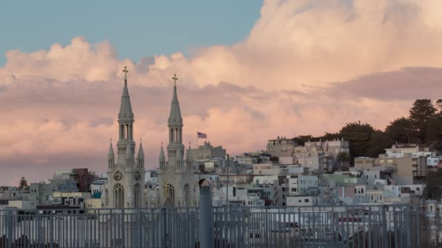 pink storm clouds over saint peter and paul catholic church, san francisco - north beach san francisco stock videos and b-roll footage