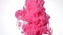 Pink watercolor ink in water on a white background. Fantastically cool abstract background.