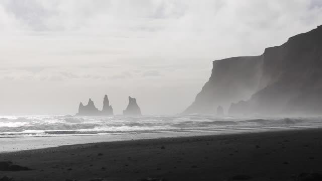 Pinnacles and black beach at V��k �� M��rdal, Southern Iceland