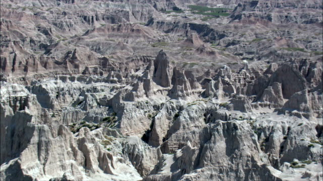 pinnacles in the badlands  - aerial view - south dakota, jackson county, united states - badlands national park stock videos & royalty-free footage