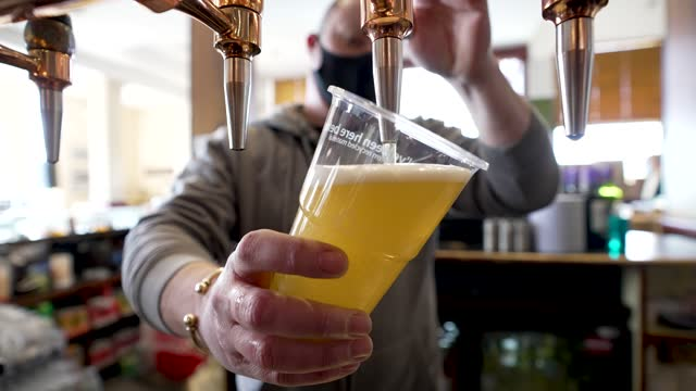 pint is poured at alexandra palace the terrace bar on april 12, 2021 in london, united kingdom. england has taken a significant step in easing its... - finance and economy stock videos & royalty-free footage