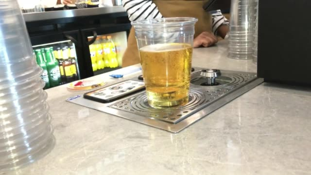 pint of beer being poured from the bottom up at goal line bar in new tottenham hotspur football stadium - magnet stock videos & royalty-free footage