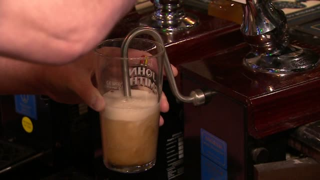 pint of beer being poured in pub in preston - alcohol drink stock videos & royalty-free footage