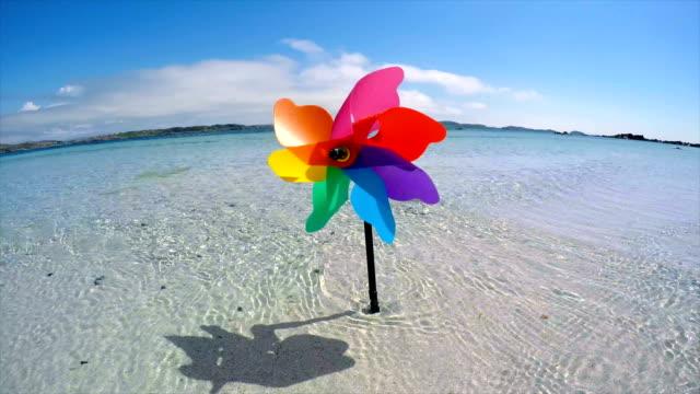 pinwheel in sea - girandola video stock e b–roll