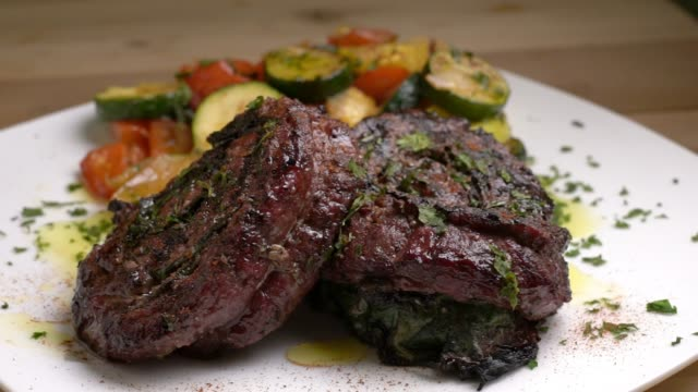 pinwheel steaks plated with squash - steak plate stock videos & royalty-free footage