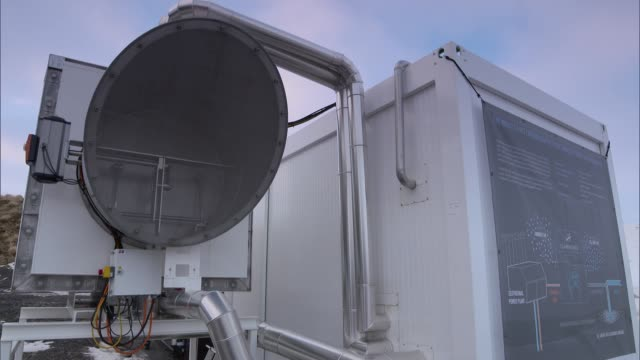 pioneering technology removes carbon dioxide from air; iceland: ext / snow air views / aerials carbon dioxide removal plant and surrounding mountains... - island stock-videos und b-roll-filmmaterial