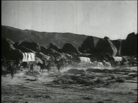1940 reenactment pioneers traveling in wagon train / united states - explorer stock videos & royalty-free footage