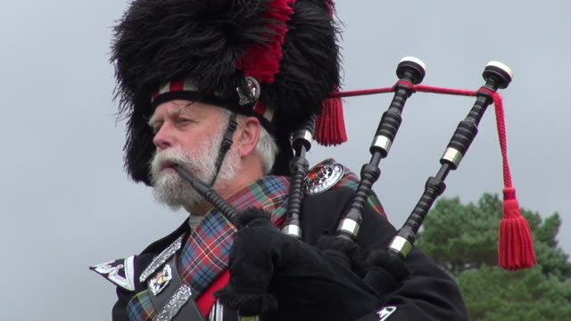 ms pipe band performing at braemar royal highland games / braemar, aberdeenshire, scotland - scottish culture video stock e b–roll