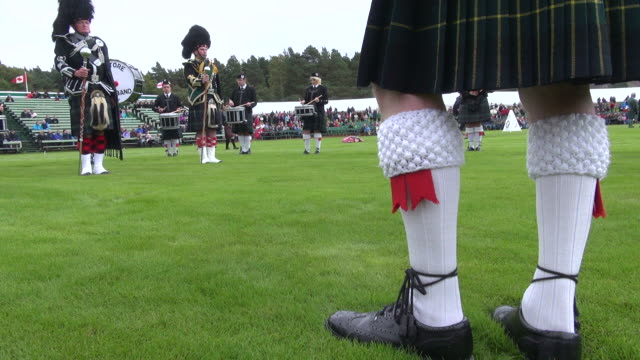 ms pipe band performing at braemar royal highland games / braemar, aberdeenshire, scotland - scottish culture stock videos & royalty-free footage