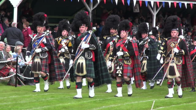 ms pipe band performing at braemar royal highland games / braemar, aberdeenshire, scotland - highland games stock videos & royalty-free footage