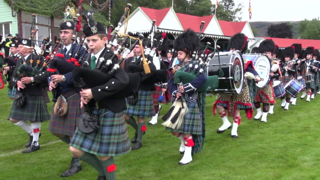 ms pan pipe band performing at braemar royal highland games / braemar, aberdeenshire, scotland - scottish culture video stock e b–roll