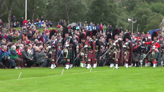 ms pan pipe band performing at braemar royal highland games / braemar, aberdeenshire, scotland - highland games stock videos & royalty-free footage