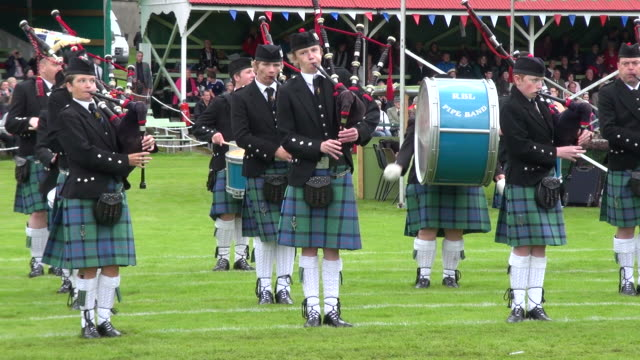 ms pipe band performing at braemar royal highland games / braemar, aberdeenshire, scotland - bagpipes stock videos & royalty-free footage