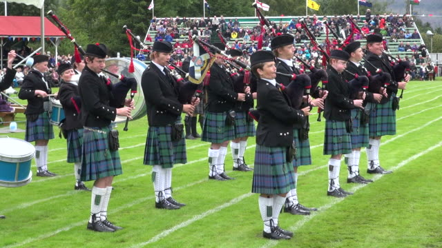 MS Pipe band performing at braemar royal highland games / Braemar, Aberdeenshire, Scotland