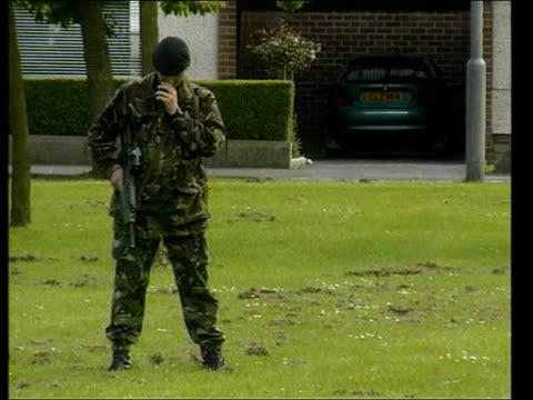 pipe bombs discovered itn northern ireland county armagh lurgan ext army bomb disposal unit van along to stop nearby to another van with two soldiers... - county armagh stock videos and b-roll footage