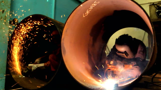 pipe factory welder and fitter at work - lavoro e impiego video stock e b–roll