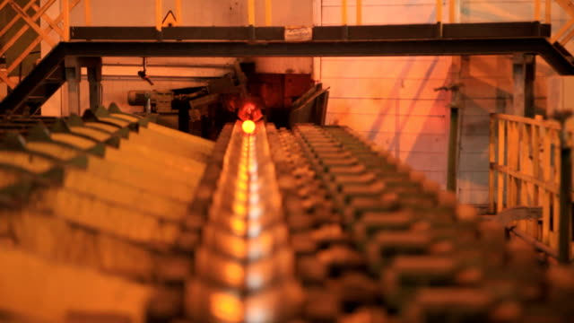 Pipe with a flame moves on the conveyor