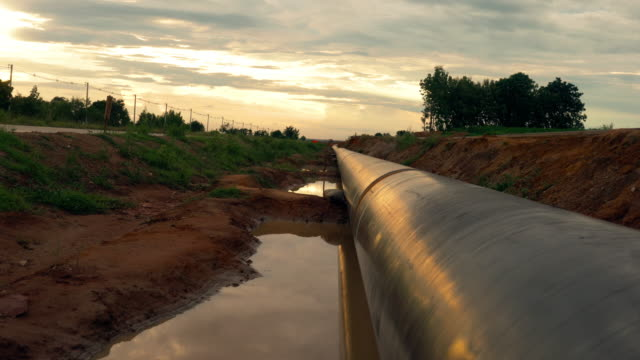 pipeline at sunset - installing stock videos and b-roll footage