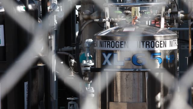 stockvideo's en b-roll-footage met a pipeline carries hydrogen gas produced in the tri generation power and hydrogen device at the orange county sanitation district waste treatment... - geproduceerd segment