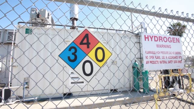 vídeos de stock, filmes e b-roll de pipeline carries hydrogen gas produced in the tri generation power and hydrogen device at the orange county sanitation district waste treatment... - segmento editado