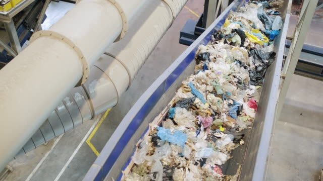 pipelines and conveyor belt inside recycling facility - waste management stock videos & royalty-free footage