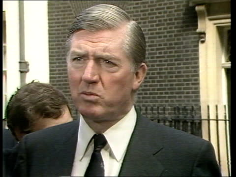 background l ENGLAND London Downing St No 10 MS Cecil Parkinson out through door towards as others out behindCMS CECIL PARKINSON INTVW SOF...