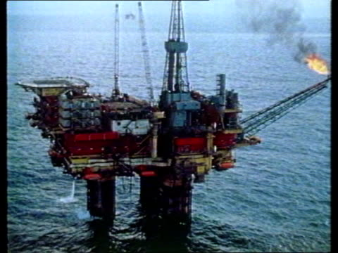 piper alpha explosion: background:; piper alpha explosion: background:; airv oil rig track l-r airv oil rig as others in b/g tx 7.7.88/nat - alpha cell stock videos & royalty-free footage