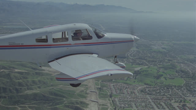 a-a piper cherokee over mountains - propeller aeroplane stock videos & royalty-free footage