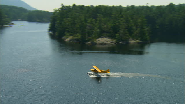 AIR TO AIR, Piper Cub floatplane taking off from water, Megunticook Lake, Maine, USA