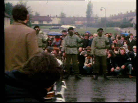 piper leads funeral procession of hunger striker bobby sands masked ira members fire gun salute over coffin draped in irish tricolour northern... - アイルランド共和国点の映像素材/bロール