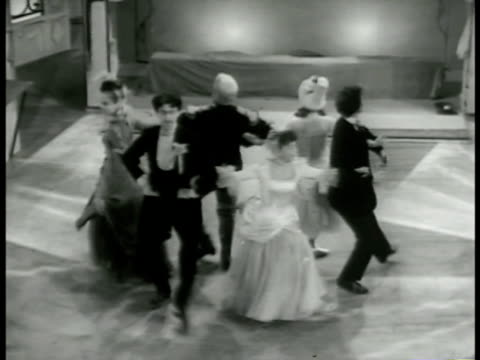 vídeos de stock e filmes b-roll de piper pushing the bride & groom apart gathering other dancers over to them the formation turns into a modified square dance with the three couples. - dança quadrada