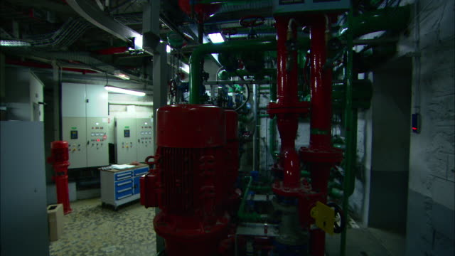 pipes and machines are contained in a boiler room. - boiler stock videos & royalty-free footage