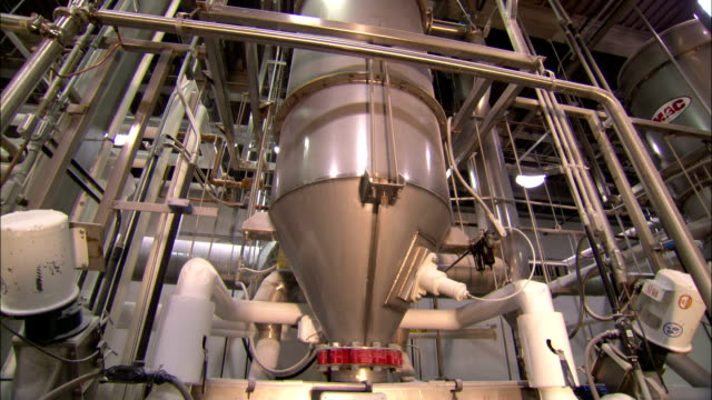 pipes attached to a large funnel in a jellybean manufacturing plant. - jellybean stock videos & royalty-free footage