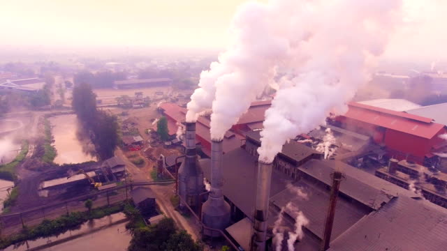 Pipes throwing smoke in the atmosphere while sugar produce, Aerial view