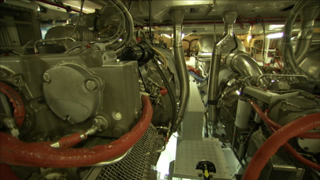 pipes, tubes, and machinery fit tightly into the engine room in a wally yacht. - motor stock-videos und b-roll-filmmaterial