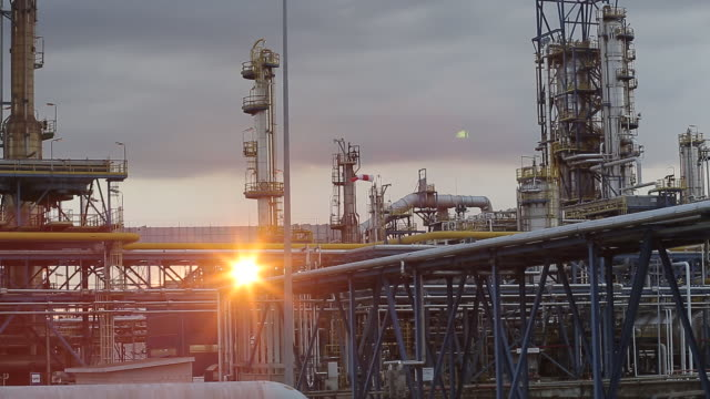 pipework runs between storage silos at the grupa lotos sa oil refinery at dusk in gdansk poland on tuesday july 28 2020 polish refiner pkn orlen won... - water surface stock videos & royalty-free footage