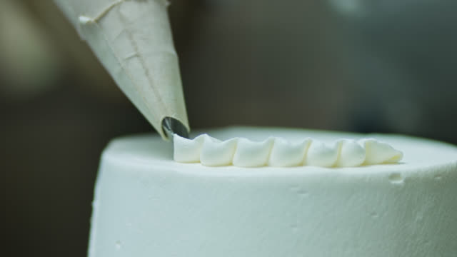 piping frosting onto cake - cake stock videos & royalty-free footage